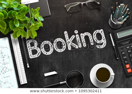 Booking Handwritten on Black Chalkboard. 3D Rendering. Stock photo © tashatuvango