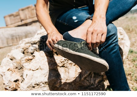 Joven toma calcetín primer plano jóvenes Foto stock © nito