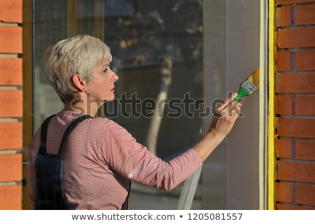 Stock photo: Old shop renovation, woman painting window