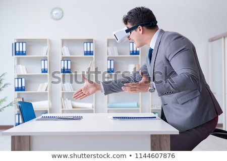 man in vr headset with virtual interface at office Stock photo © dolgachov