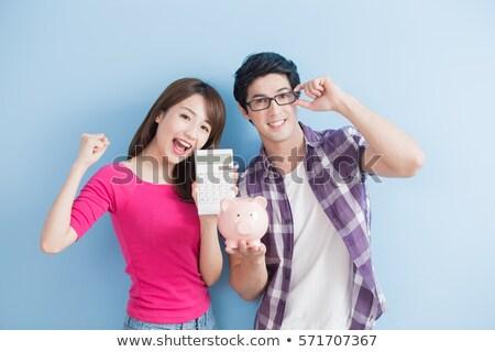 Couple Holding Pink Piggybank Stock photo © AndreyPopov