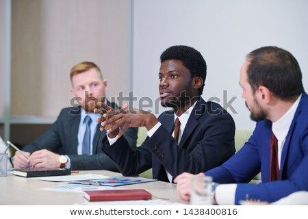 Young confident delegate or trader explaining idea Stock photo © pressmaster
