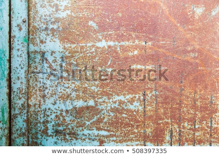 Roestige gekleurd metaal gebarsten verf grunge Stockfoto © boggy