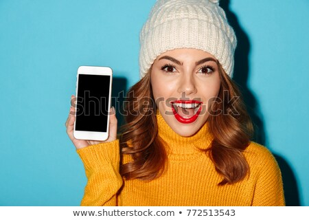 Stockfoto: Close Up Of Woman With Smartphone In Winter Hat