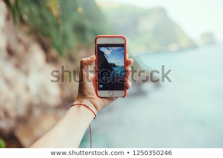 Millennial man holding picture frame and phone Stock photo © wavebreak_media