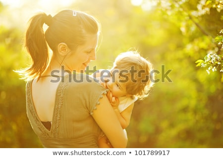 Beautiful mother and little baby boy in forest Stock photo © Lopolo