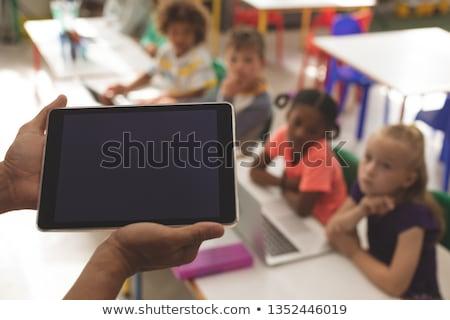 Close-up of school kids standing in row in classroom of elementary school Stock photo © wavebreak_media