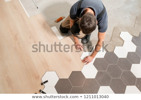 Professional contractor laying flooring at home Stock photo © Elnur