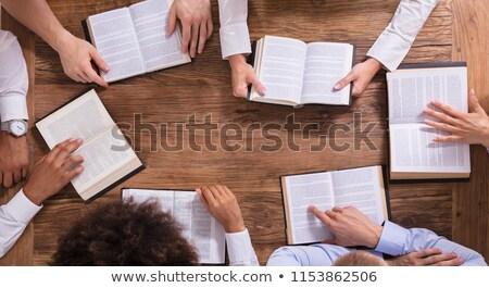 Elevated View Of People Reading Holy Books Stock photo © AndreyPopov