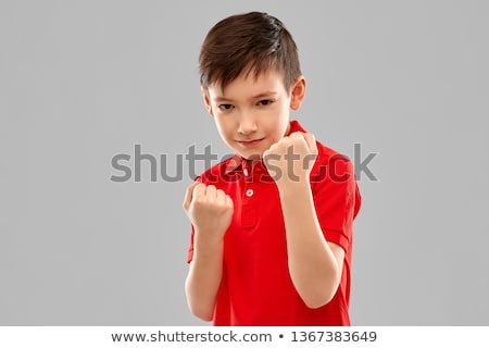 boy in red t-shirt showing fists or boxing Stock photo © dolgachov