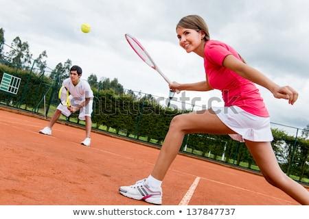 Kép boldog nő férfi játszik teniszpálya Stock fotó © deandrobot
