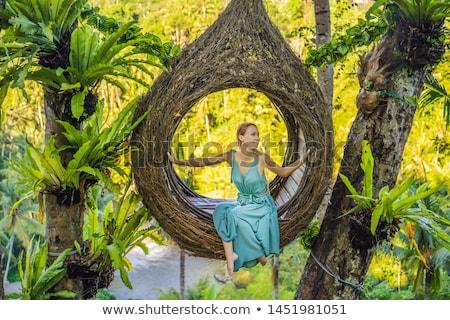 Bali trend, straw nests everywhere. Young tourist enjoying her travel around Bali island, Indonesia. Stock photo © galitskaya