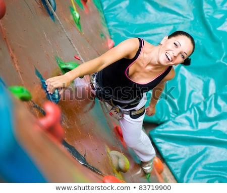child climbing on a wall in an outdoor climbing center Stock photo © galitskaya