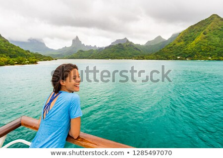 Tahiti cruise ship travel vacation woman on balcony of yacht traveling on exotic oceania adventure Stock photo © Maridav
