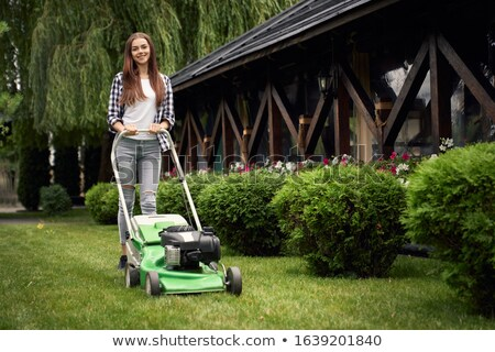 young beautiful woman gardening and trimming the lawn stock photo © nobilior