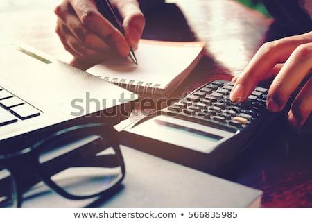 Foto stock: Imposto · calculadora · caneta · números · renda · voltar