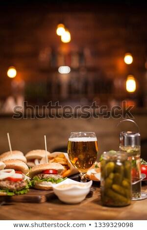 Mini queijo burger cerveja picles tomates Foto stock © aladin66