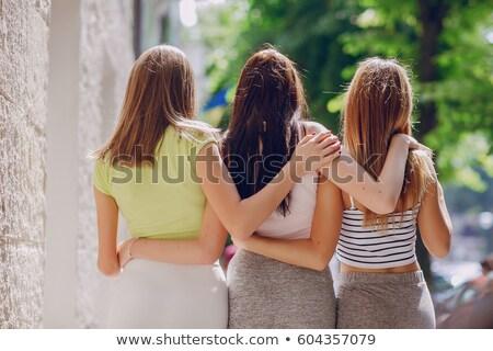 drie · vriendinnen · witte · geïsoleerd · meisje · glimlach - stockfoto © ruslanomega