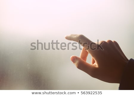 The girl behind wet glass from a rain Stock photo © olgaaltunina