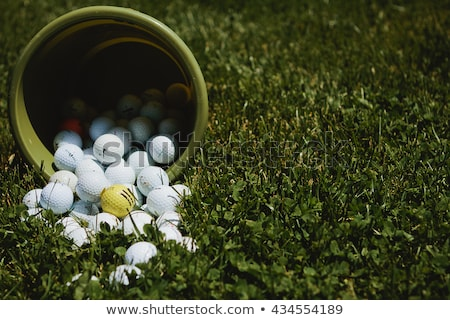 Stock photo: A golf ball lands near the hole on the green.