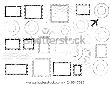 Foto d'archivio: Postage Stamp With At Symbol Isolated On White