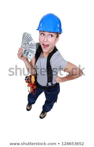 female electrician holding bunch of dollars Stock photo © photography33
