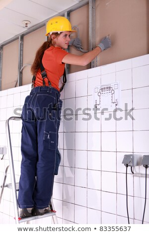 Female artisan installing wiring system Stock photo © photography33