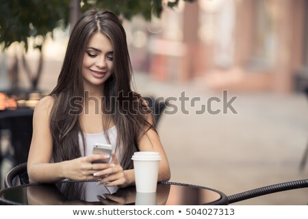 Young woman drinking a cup of expresso coffee Stock photo © photography33