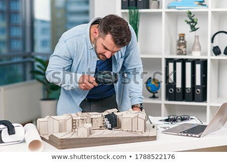 Architect using model to sell homes Stock photo © photography33
