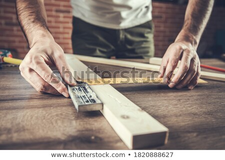 carpenter measuring plank of wood stock photo © photography33