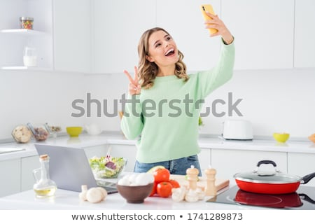 young woman having fun on the Internet Stock photo © photography33