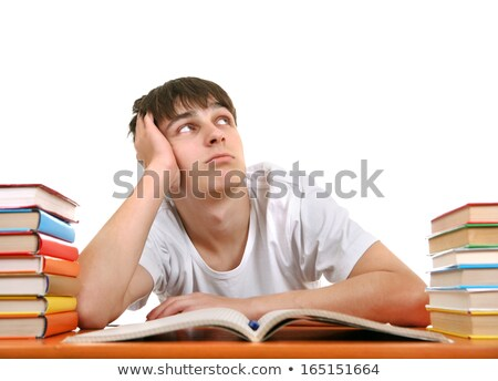 Bored student with a pile of homework Stock photo © photography33