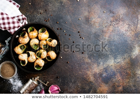 snails with butter and parsley stock photo © m-studio