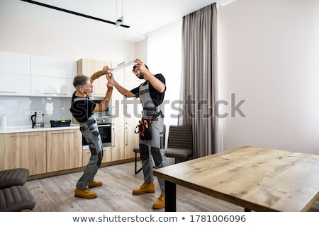 two electricians working on the ceiling Stock photo © photography33