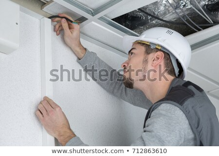 Man concealing wiring Stock photo © photography33