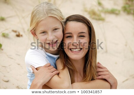 Mother and daughter sat on sand dune Stock photo © photography33