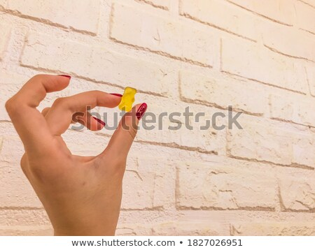 hands full of red bonbons Stock photo © dolgachov