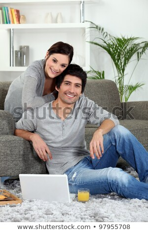 Pretty young woman laid in front of laptop Stock photo © photography33