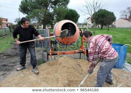 Labourers using a cement fixer Stock photo © photography33