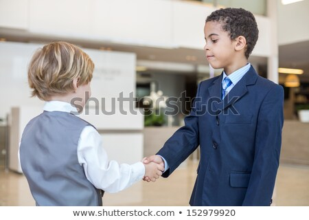 metis person and white person shaking hands stock photo © photography33
