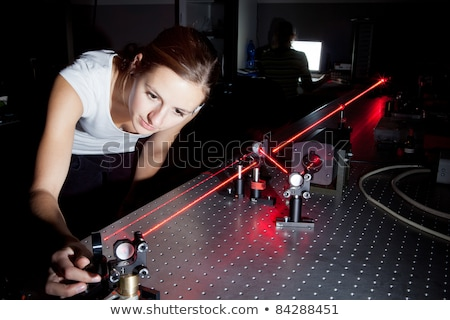 Female scientist doing research in a quantum optics lab  Stock photo © lightpoet