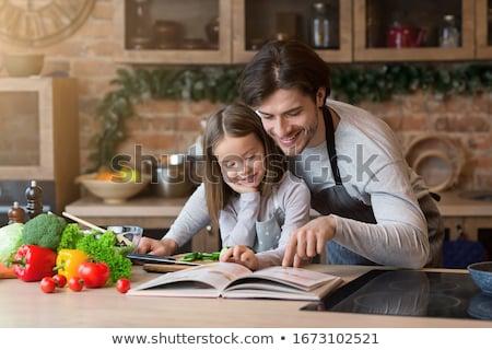 a man reading a recipe book Stock photo © photography33