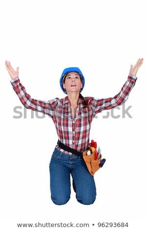 craftswoman kneeling and raising hands Stock photo © photography33