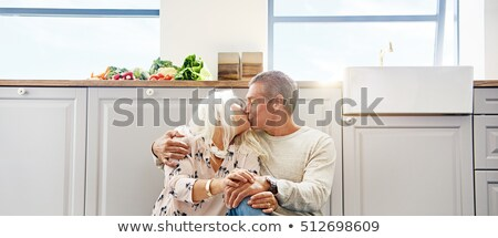 Mature couple kissing tenderly Stock photo © photography33
