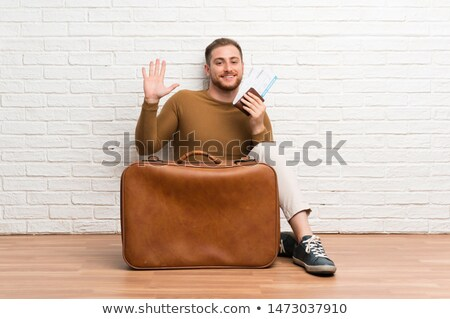 Man with suitcase waving goodbye Stock photo © photography33