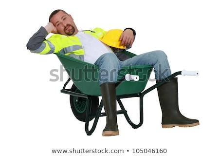 lazy worker slumped in wheelbarrow stock photo © photography33
