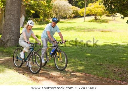 Nyugdíjas pár hegyikerékpározás kívül mosoly hegy Stock fotó © wavebreak_media