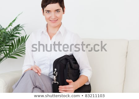 Brunette short-haired woman sitting on a sofa in a waiting room Stock photo © wavebreak_media