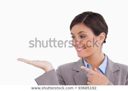 Close up of female entrepreneur looking and pointing at her palm against a white background Stock photo © wavebreak_media