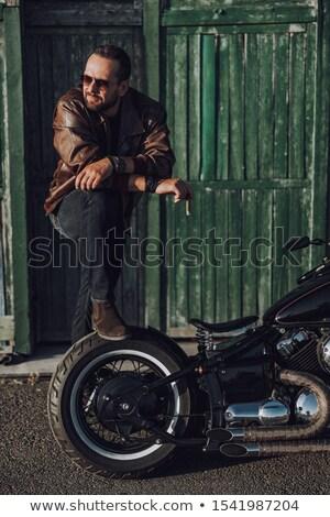 adulto · marrom · jaqueta · de · couro · estúdio · cintura · retrato - foto stock © snyfer